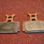 What is the best way to clean a contaminated brake pad?
